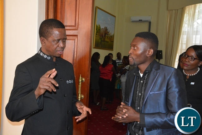 President Edgar Lungu chats with Brian Bwembya at State House during the meeting with Mandela Washington Fellowship of young African Leaders