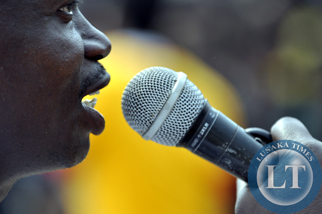 An entertainer only identified as Chatengwa of Lusaka speaks through the public address system at the Mukulapembe Traditional ceremony in Luwingu recently.