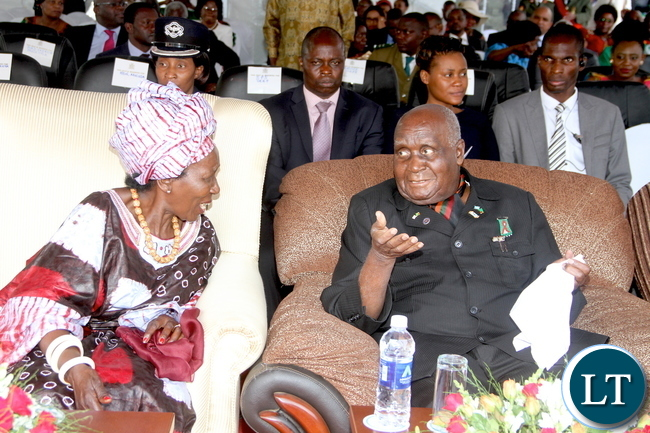 First Republican President Dr Kenneth Kaunda speaks with Vice-President Inonge Wina during Zambia's 51st Independence anniversary Celebrations at Heroes Stadium on Saturday, October 24,2015 -Picture by THOMAS NSAMA