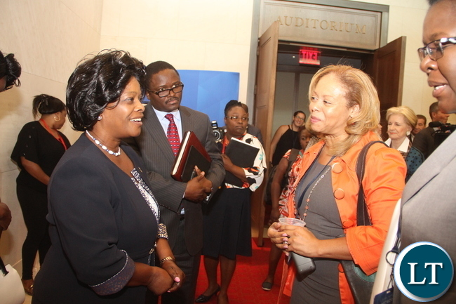 First Lady  Esther Lungu talks to American Cancer Society Global vice-President Ann McMikel during the Global Network Women's Summit at  George W. Bush Presidential Centre in Dallas, Texas on Tuesday, September 22,2015 -Picture by THOMAS NSAMA