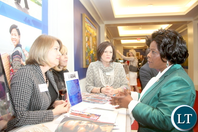First Lady Esther Lungu talks to Akola Jami Peebles (bue and white drees)l when she toured women projects after attending  the First Ladies roundtable : improving maternal and Child Health  conference in Africa in Dallas , Texas  on Monday, September 21,2015  -Picture by THOMAS NSAMA