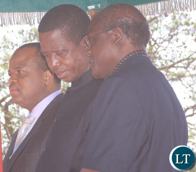 Mnister of Justice Ngosa Simbyakula whispering at President Lungu