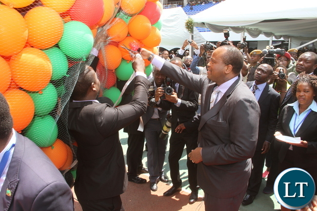 King Mswati of Swaziland releases balloons  during  Zambia's 51st Independence Day celebrations at Heroes Stadium  in Lusaka on  Saturday, October 24,2015 -Pictures by THOMAS NSAMA