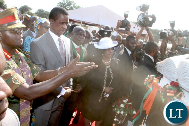 President Lungu and First Lady Esther Lungu listens to Brig Gen Bishop Vincent Mwenya during the Ground breaking ceremony for the New Cathedral and Interdenominational Thanks Giving Church Service at woodlands reserve forest area in Lusaka on Sunday, October 25,2015 -Pictures by THOMAS NSAMA