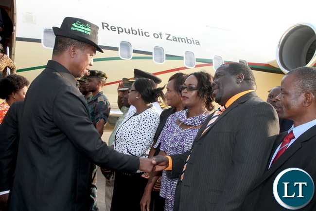 President Lungu being welcomed by Information minister Chishimba Kambwili on arrival in Ndola where he made a stop over en-route to Kitwe on Thursday, October 29,2015 -Pictures by THOMAS NSAMA