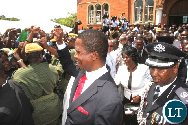 President Lungu flashes the PF party symbol after the memorial service of Late President Michael Sata at St Ignatius Catholic Church in Lusaka on Wednesday, October 28,2015 -Picture by THOMAS NSAMA