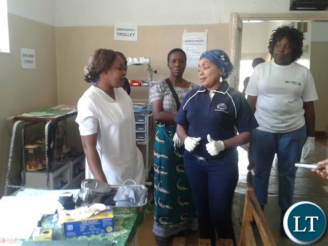 Police Commissioner Lombe Kamukoshi during the cleaning of Kabwe General Hospital female wards in commemoration of the 51st Independence Day celebration
