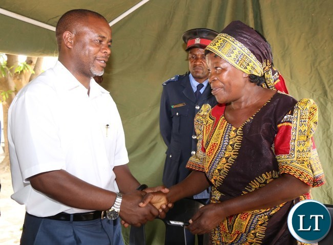 Her royal highness chieftaniss Mpanshya talks to Lusaka Province Permanent Secretary Stardy Mwale after she officially handed over 2000 hectare's of land for the construction of government infrastructure in Rufunsa district