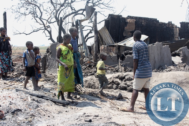 A family going through the remains of their burnt house in Imuba Village of Katongo Lower area in Mongu after the whole village had been burnt to ashes.