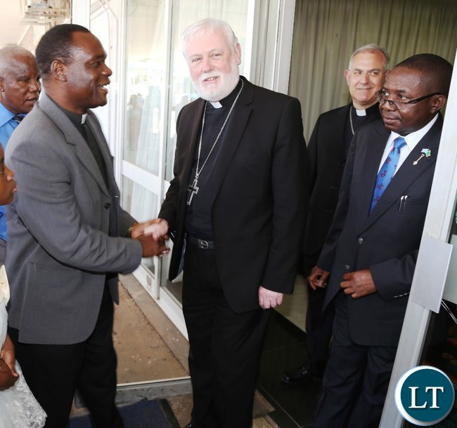 ZEC National Pastoral Coordinator Fr. Justin Matepa welcomesHis excellency Mgrs.Poul Richard Gallgher (L) flanked by Foreign Affairs Deputy Minister Reyford Mbulu (r) at Kenneth Kaunda International Airport yesterday 07-11-2015. Picture by ROYD SIBAJENE/ZANIS