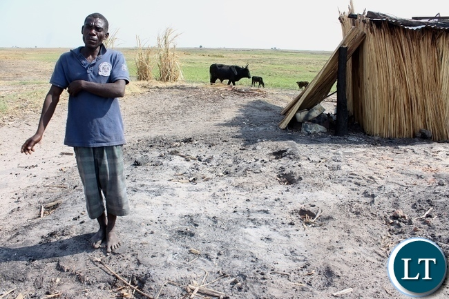 Lutopu Lutopu of Imuba Village standing at the site where his 2 ½ year old son died in the house during a firestorm which burnt the entire village to ashes in Lower Katongo area in Mongu.