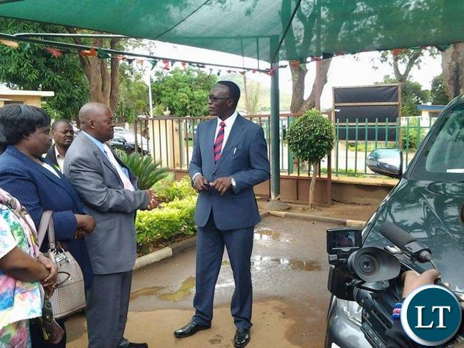 Eastern Province Permanent Secretary Chanda Kasolo talking to Chadiza District Commissioner George Phiri before handover a vehicle to him in Chipata