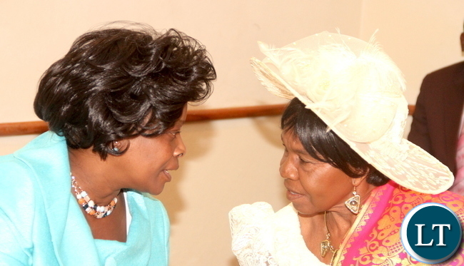 First Lady Esther Lungu with Chieftainess Nkomeshya during the launch of Mama Kankasa Health Voucher at Pamodzhi Hotel on Thursday, November 5,2015 -Picture by THOMAS NSAMA
