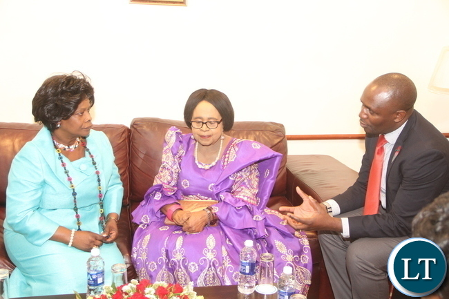 First Lady Esther Lungu listens to Planned Parenthood Association of Zambia Executive Director Edford Mutuma (R) as Mama Kankasa looks on during the launch of Mama Kankasa Health Voucher at Pamodzhi Hotel on Thursday, November 5,2015 -Picture by THOMAS NSAMA