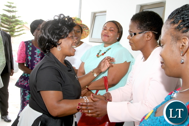 First Lady Esther Lungu being welcomed by ZAF Commander Lt Gen Eric Chimese's wife Sharon on arrival at ZAF Chamber Valley Officers' Mess for the First Lady Fundraising Ladies' luncheon to raise funds for the construction of the Air Headquarters Hospital at City Airport in Lusaka on Saturday , October 31,2015 -Picture by THOMAS NSAMA