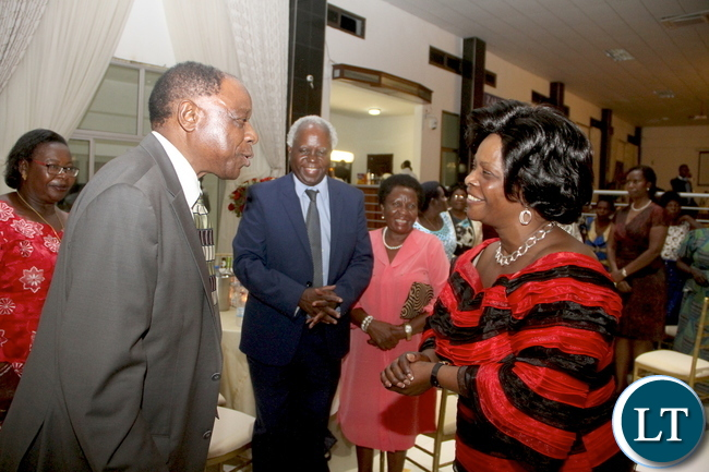 First Lady Esther Lungu speaks with former Zambia Army Commander Gen Benjamin Mibenge during a wedding for his son Bweupe Mibenge and PF Chifubu member of Parliament Susan Kawandami's daughter Chinyimba at ZAF Chamba Valley Officers' Mess in Lusaka on Saturday, November 14,2015 -Picture by THOMAS NSAMA