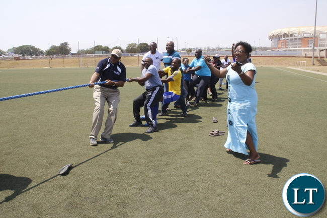Bank of Zambia Governor Dr Danny Kalyala taking part in the a Tug of War during the 3rd Zufiaw Sport festival at OYDC.