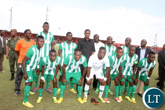 President Lungu pose for a photograph with Might Mufulira Wanderers Soccer team shortly before the match with Nkana in Kitwe on Sunday, November 1,2015 -Picture by THOMAS NSAMA