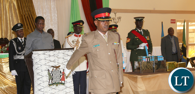 President Edgar Lungu watches as Major Hassan Amin from Kenya Defence Forces