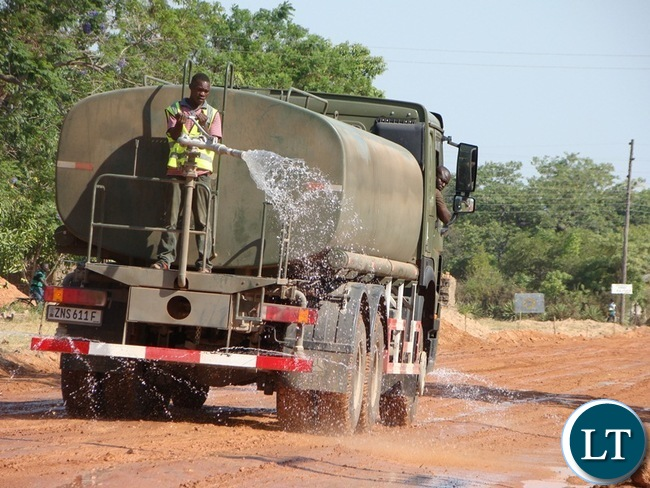 ZAMBIA National Service has been empowered with some more road equipment machinery by the government. In the picture is a water bowser truck watering in of the Mochipapa township roads in Choma.