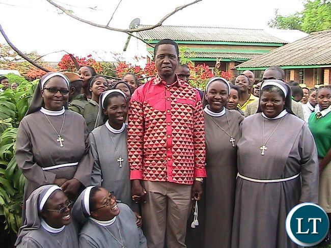 President Edgar Lungu poses for a photograph with catholic nuns at Ibenga girl's secondary school in Mpongwe shortly after visiting the facility.