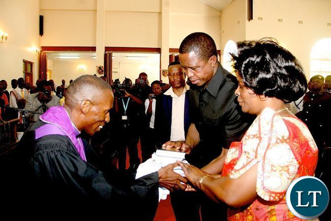 President Lungu and First Lady Esther Lungu receives a Bible from UCZ Bishop Sydney Sichilima during the Church service at St Margaret UCZ congregation in Kitwe on Sunday, November 1,2015 -Picture by THOMAS NSAMA