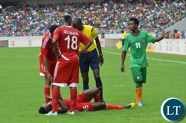 Lubambo Musonda (r) standing over Atahir El El Babikir (15) of Sudan on November 15, 2015 ina 2018 world Cup qualifier at Levy Mwanawasa Stadium in Ndola. Zambia won 2-0