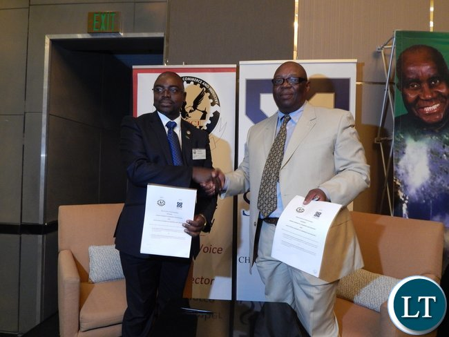Zambia Association of Chambers of Commerce and Industry vice-president Dr. Chi..Kawesha and South Africa Chamber of Commerce and Industry representative, Mr. Vuyo Khumalo after signing a memorandum of understanding at the launch of the Zambia-South Africa Business Council in Johannesburg