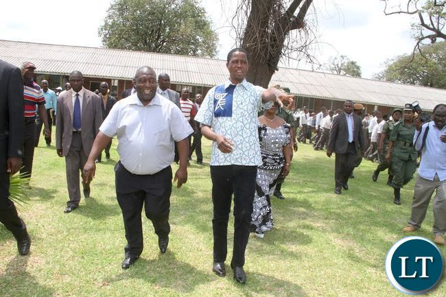 President Lungu with Copperbelt Minister Mwenya Musenge during a tour of Mukuba Secondary school pupils. This was when the Head of State visited his former school in Kitwe on November 2,2015 -Picture by THOMAS NSAMA