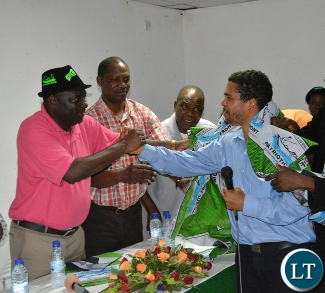 PF Secretary General Davies Chama (far left) receives a UPND defector Aggefrey Brill (far right) as PF members of the Central Committee Paul Moonga (next to Mr Chama) and Siacheye Madyankuku looks on