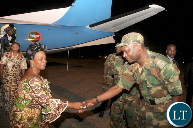First Lady Esther Lungu  greets flight crew member Brenda Phiri on arrival at City Airport from Mongu District where she handover of assistive devices to the victims of Konzo diseases in Luatembo village  on Tuesday, December 15,2015 -Pictures by THOMAS NSAMA