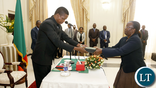 President Edgar Lungu receives from Madam Doris Mwinga clerk of the National assembly the Constitution Amendment bill that was passed by parliament last week. President Edgar Lungu reiterating that he would assent to the document in the first week of January, next year. PICTURE BY EDDIE MWANALEZA/STATEHOUSE . 23-12-2015