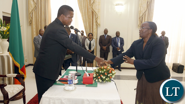 President Edgar Lungu recieves from Madam Doris Mwinga clerck of the National assembly the Constitution Amendment bill that was passed by parliament last week. President Edgar Lungu reiterating that he would assent to the document in the first week of January, next year. PICTURE BY EDDIE MWANALEZA/STATEHOUSE . 23-12-2015