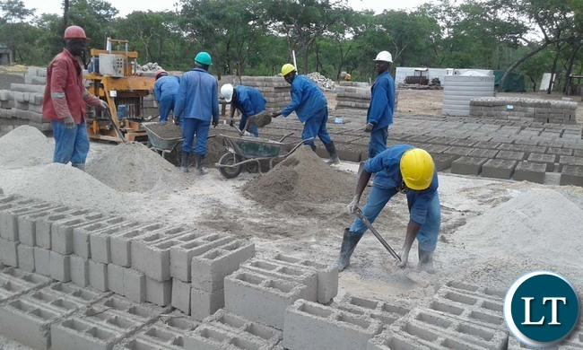 ANITA Construction Limited employees moulding blocks for the 20 low-cost housing units under construction for civil servants in Mulobezi District. Picture by CHILA NAMAIKO