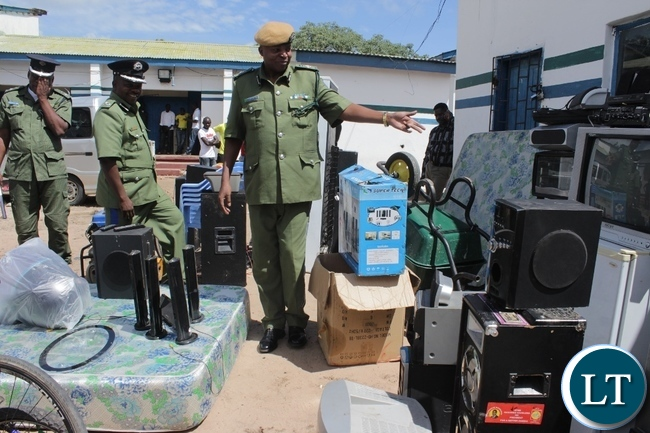 Western Province Commissioner of Police Charles Lungu (front) inspecting recovered stolen items worth thousands of kwacha at Mongu Central Police Station today. Items were recovered in an operation carried this month and eight suspects are in custody