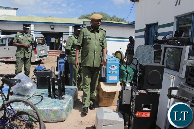 Western Province Commissioner of Police Charles Lungu (front) inspecting recovered stolen items worth thousands of kwacha at Mongu Central Police Station today. Items were recovered in an operation carried this month and eight suspects are in custody.
