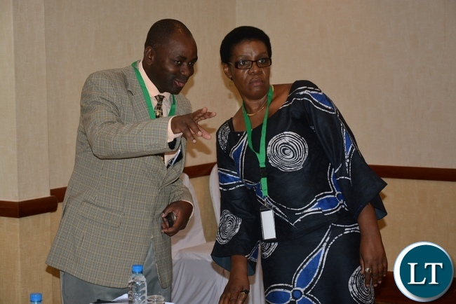 Ministry of Community Development Chief Community Development Officer Changano Ngoi chats with Self Help Africa Country Director Kalongo Chitengi at the Policy to Practice Policy Dialogue Forum at Sothern Sun Hotel
