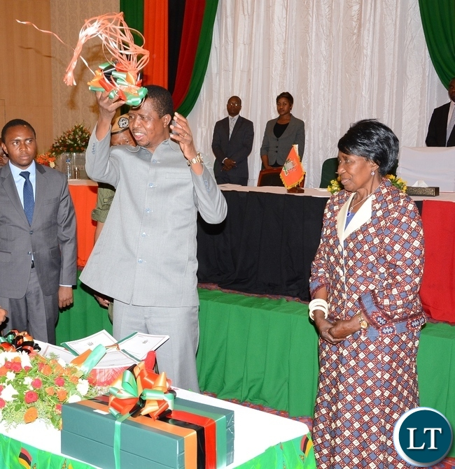 President Eedgar Lungu Cuts the ribbon whilst Vice President Inonge Wine Looks on during the Launch of the Perfromance-Based Contract system for Permanent secretaries at Government Complex