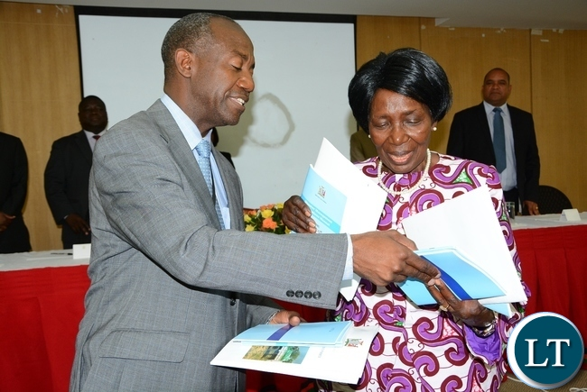Vice President Inonge Wina shows the newly launched Disaster Management Policy and Settlement with  DMMU Coordinator Patrick Kangwa