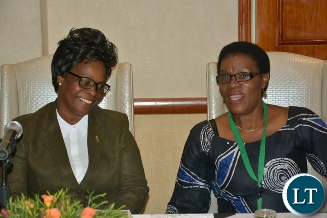 Self Help Africa Country Director Kalongo Chitengi shares a light moment with First Lady Esther Lungu at the Policy to Practice Policy Dialogue Forum at Sothern Sun Hotel