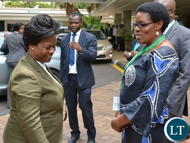 Self Help Africa Country Director Kalongo Chitengi ushers the First Lady Esther Lungu a way after the Policy to Practice Policy Dialogue Forum at Southern Sun Hotel