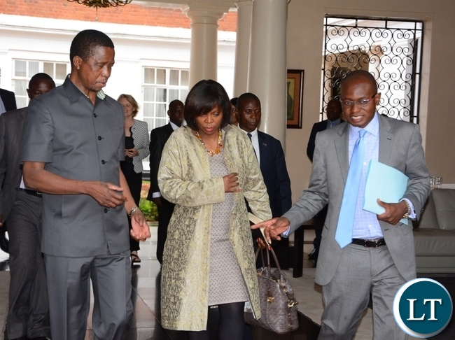 Special Assistant to the President for Press and Public Relations amos Chanda ushers a way to President Edgar Lungu and World Food Programme Executive Director Ertharin Cousin at State House