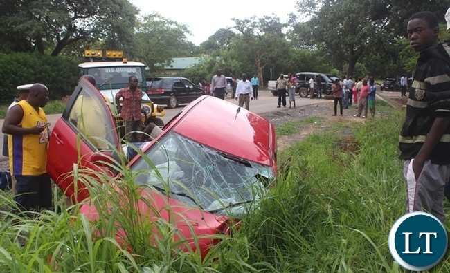 On-lookers at the accident scene involving former central province DPS