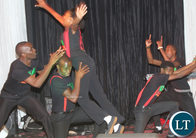 A group calling himself Alliance Zambia during its performance.