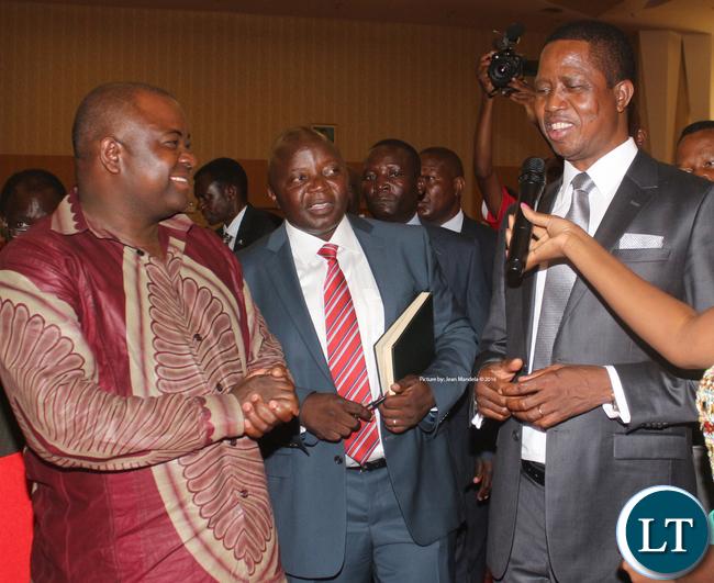 President Edgar Chagwa Lungu cracking a joke with Deputy Minister of Sport Ronald Chitotela