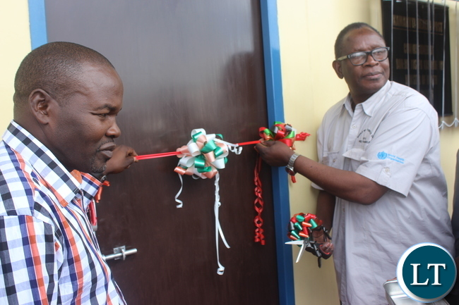 Health Minister Joseph Kasonde (right) and who is also Kabwe Central Member of Parliament commissioning a Health Post in Kabwe's Kamakuti area.