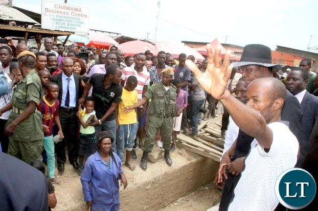 President Lungu inspects drainages in Lusaka Chawama constituency after attending Mass at St Regina Catholic Parish on Sunday, January 3,2015 -Picture by THOMAS NSAMA