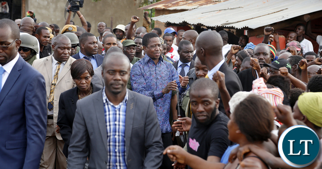 President Edgar Chagwa Lungu greets supporters at Baluba Road Side Market on Ndola - Kitwe Due High Way the First Family stopped over to Meet Traders and Exchanges Views 16-01-2016, PICTURE BY EDDIE MWANALEZA/STATEHOUSE
