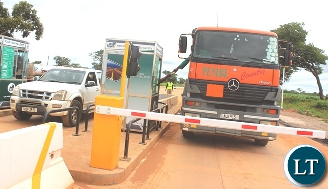 A Truck Driver making a payment at Manyumbi Tollgates in Kapiri Mposhi District following the commissioning of the same
