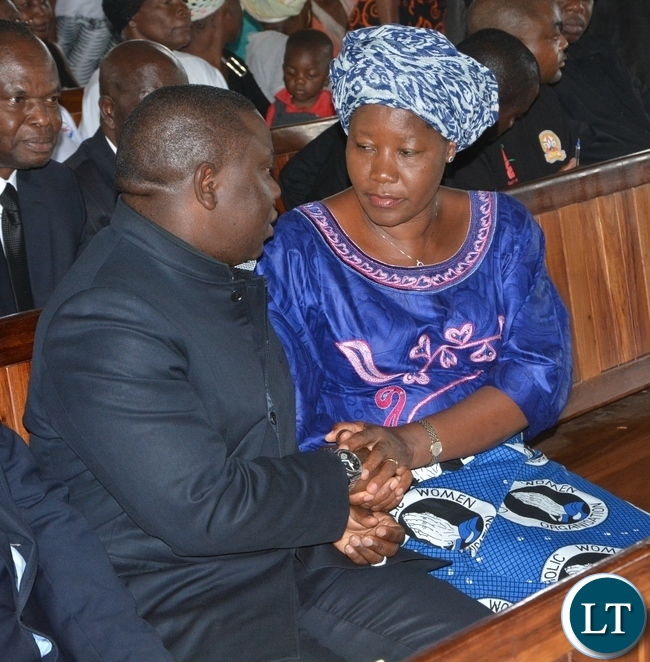 Foreign Affairs Minister Harry Kalaba welcomes FDD President Edith Nawakwi at the funeral and Church service of late ZNBC staff Faith Kandaba at Saint Pauls Catholic in Lusaka